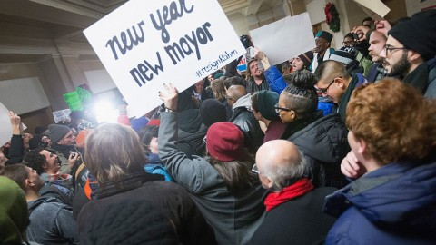 CHICAGO, IL - DECEMBER 31:  Demonstrators calling the resignation of Chicago Mayor Rahm Emanuel protest outside the Mayor's office inside City Hall on December 31, 2015 in Chicago, Illinois. The shooting deaths by police of a 19-year-old college student Quintonio LeGrier and his 55-year-old neighbor Bettie Jones and a recently released video showing the shooting of 17-year-old Laquan McDonald by Chicago Police officer Jason Van Dyke have sparked dozens of protests in the city. Yesterday Emanuel announced several changes that would take place in the police department with the hope of preventing future incidents.