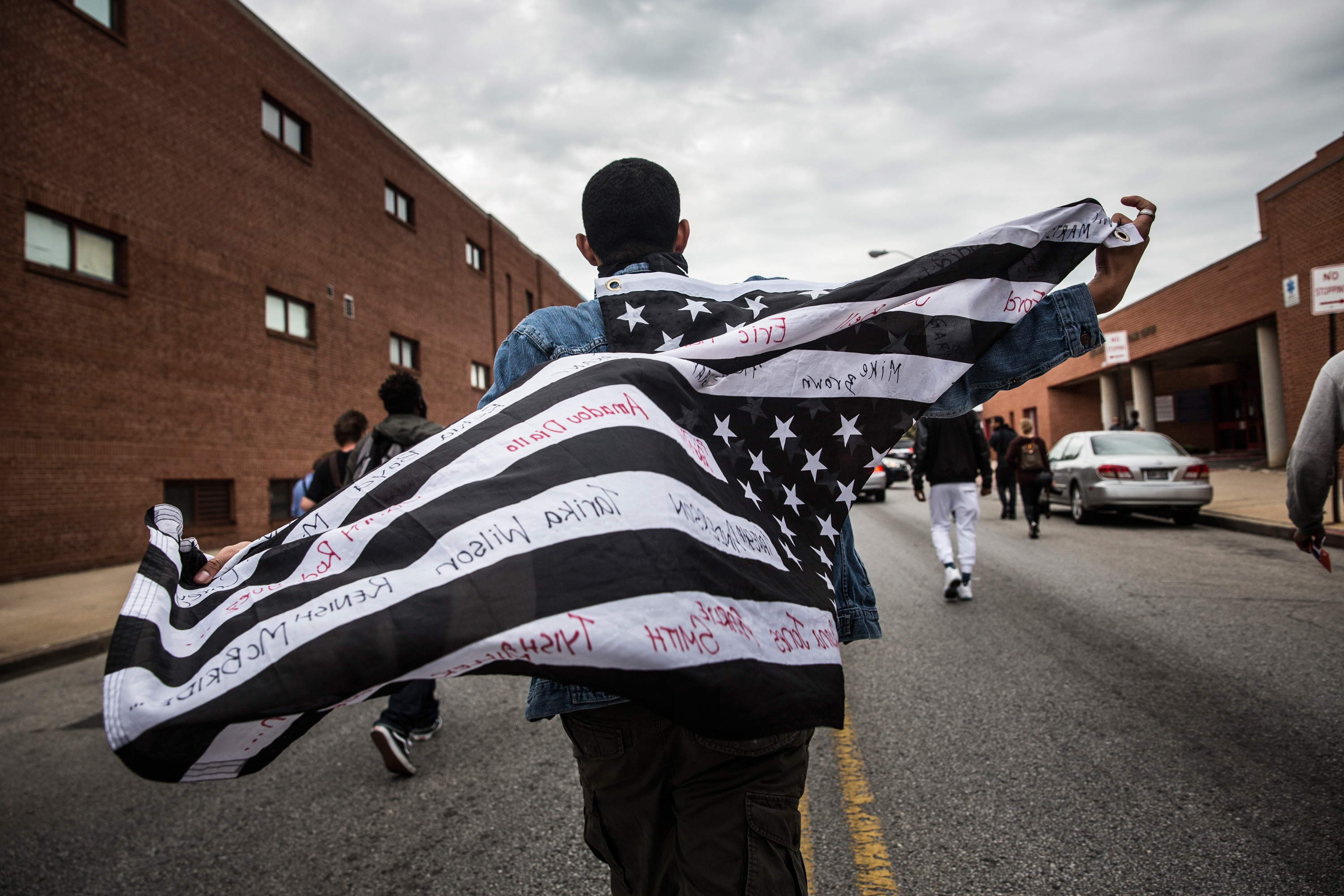 BALTIMORE, MD - MAY 01:  Protesters march through the streets in support of Maryland state attorney Marilyn Mosby's announcement that charges would be filed against Baltimore police officers in the death of Freddie Gray on May 1, 2015 in Baltimore, Maryland. Gray died in police custody after being arrested on April 12, 2015.