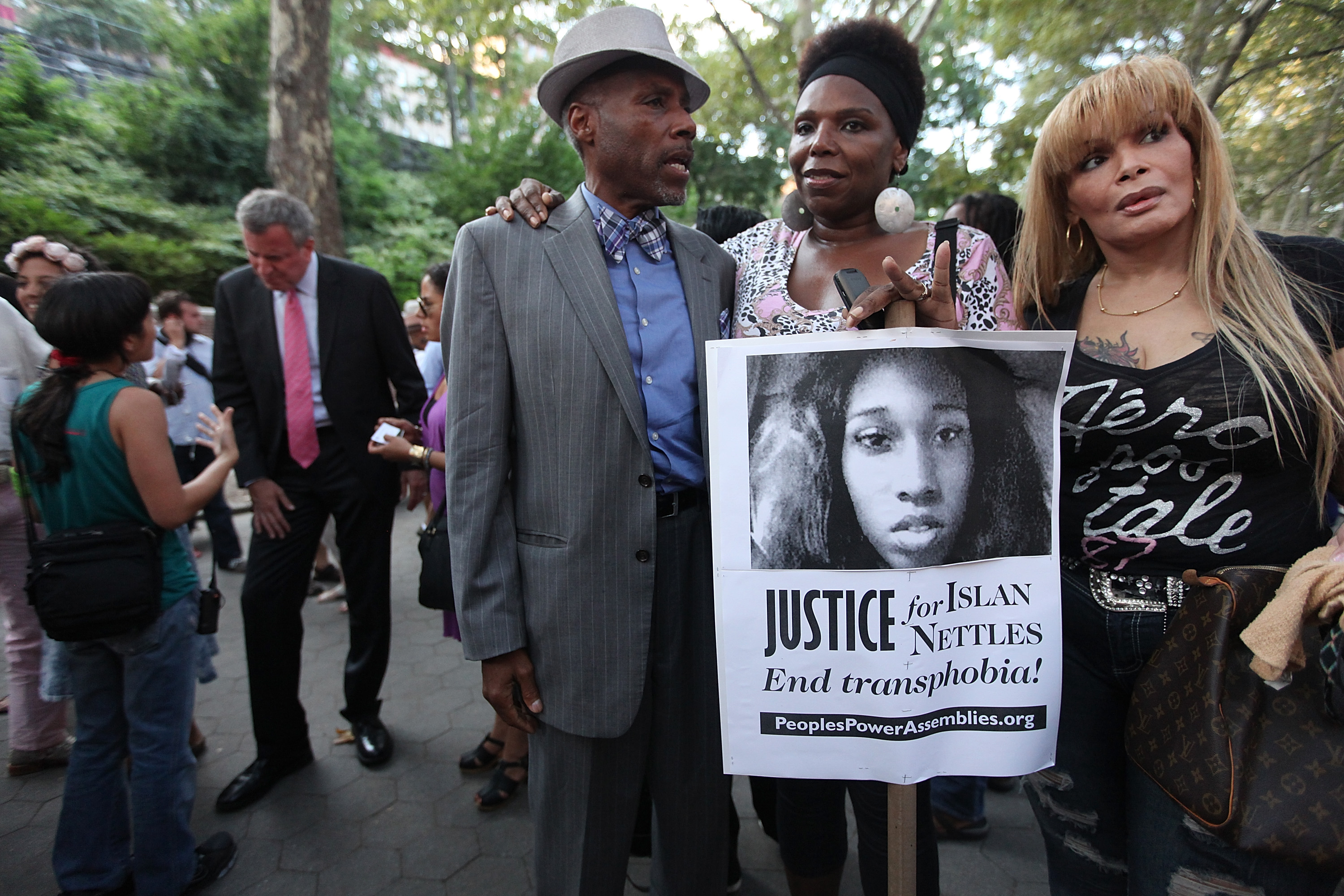 NEW YORK, NY - AUGUST 27:  People gather along with Democratic mayoral candidate Bill de Blasio (back, L) before a vigil for slain transgender woman Islan Nettles at Jackie Robinson Park in Harlem on August 27, 2013 in New York City. Nettles was severely beaten two weeks ago after being approached on the street by a group of men and later died of her injuries.  (Photo by Mario Tama/Getty Images)